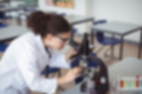 A Young Scientist looking through a micr