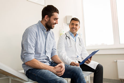 Patient with doctor getting checkup | Heelex Knoxville Medical Clinic