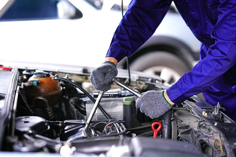 Close up of mechanic fixing a car engine mobile service Milton Keynes HC Car Repairs 2021