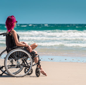 woman-in-wheelchair-at-beach