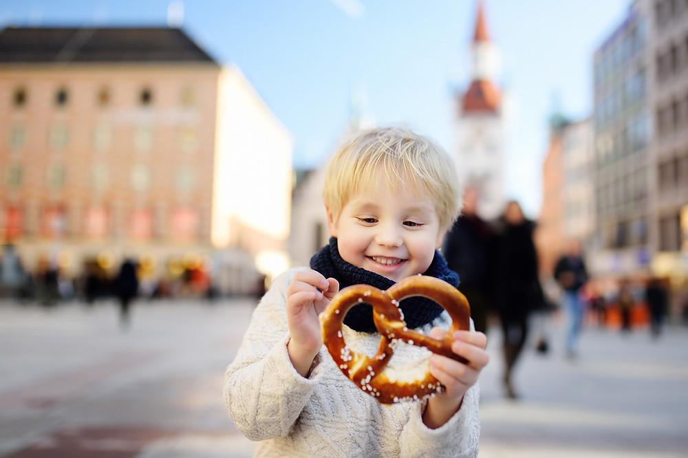 happy boy eating pretzel