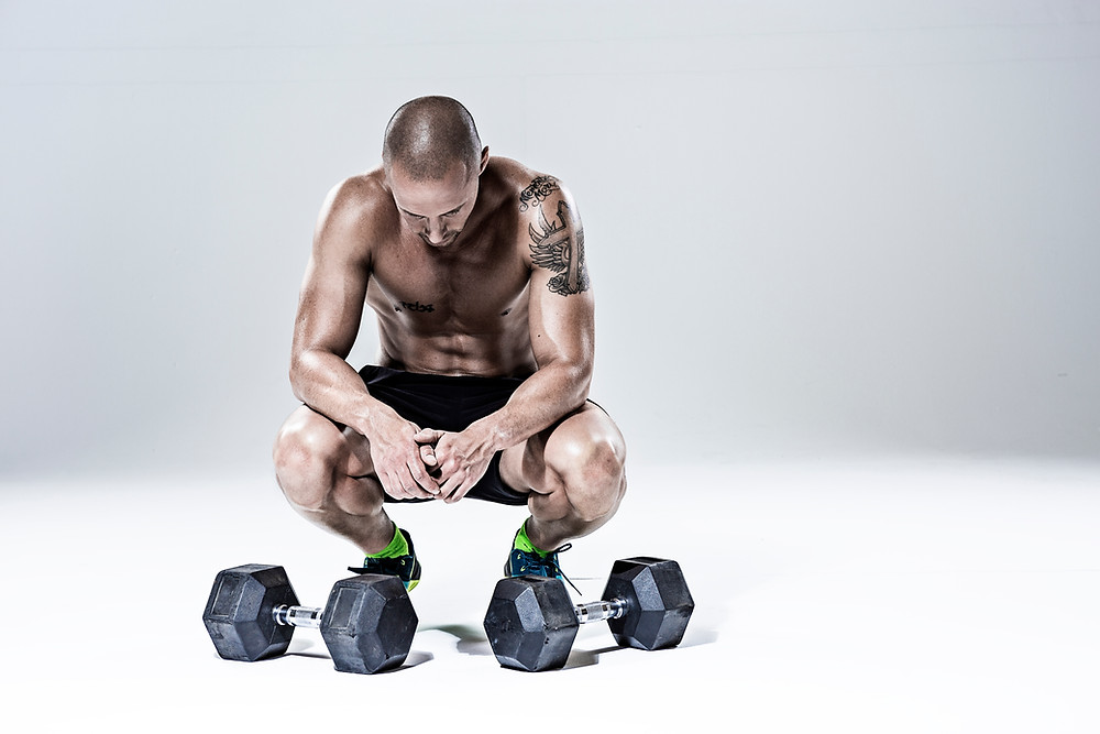 a man about to perform exercises with a pair of dumbbells