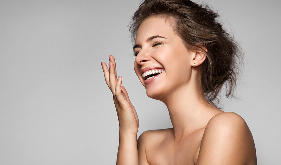 A Woman Laughing after microblading/permanent makeup