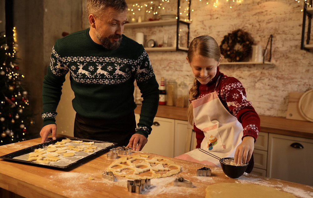 dad and daughter making Christmas cookies