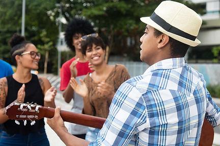 Street Performer Playing Guitar