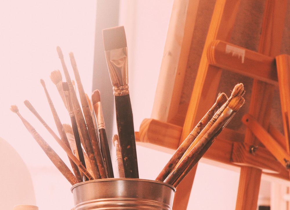 Paint brushes and a painters easel.