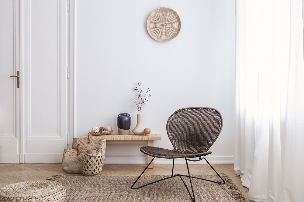Rattan chair with woven puffy and woven handbags