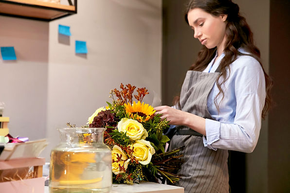 Florist Arranging Bouquet