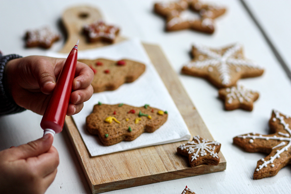 Gingerbread cookies being decorated