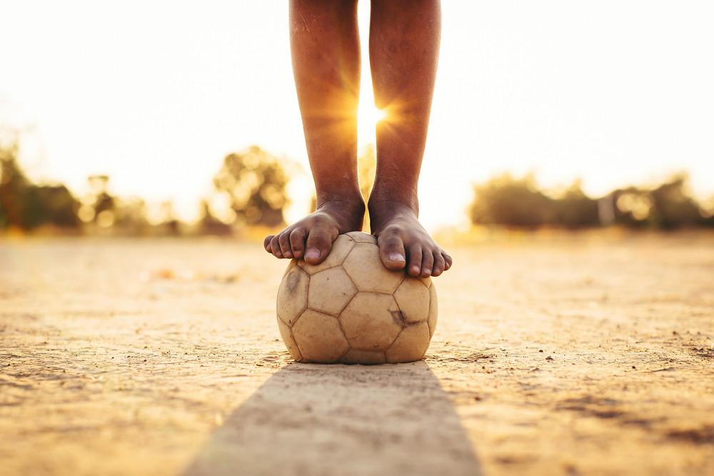 bare feet balancing on ball