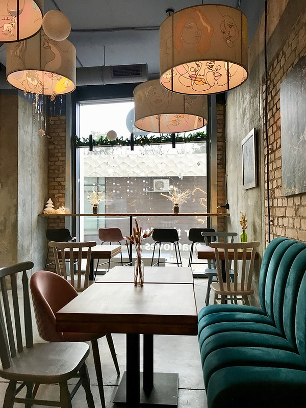 A picture of a restaurant with some very lovely lampshades