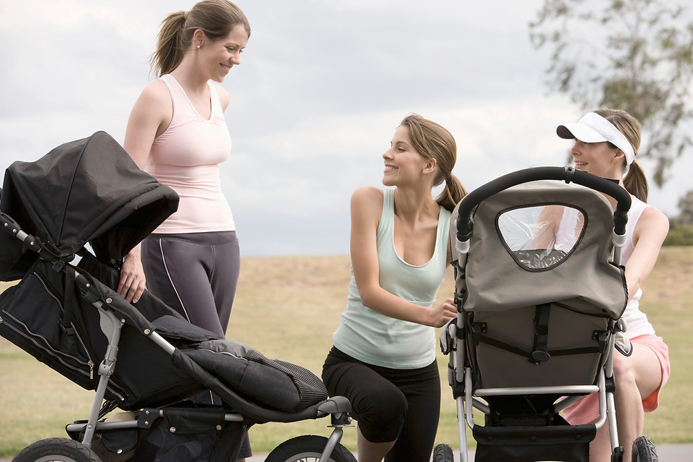 three moms exercise while pushing their children in their strollers. Catalyss Counseling provides treatment for women's issues in Colorado through online therapy and in person counseling in the Denver area 80209 and 80210