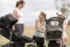Young mothers in a park with their prams