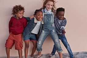 Cute Kids Posing Against Wall