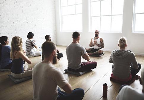 Adults Meditating in Kind Karma Yoga Class