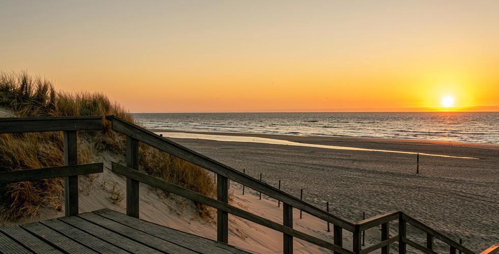 Strand zonsondergang