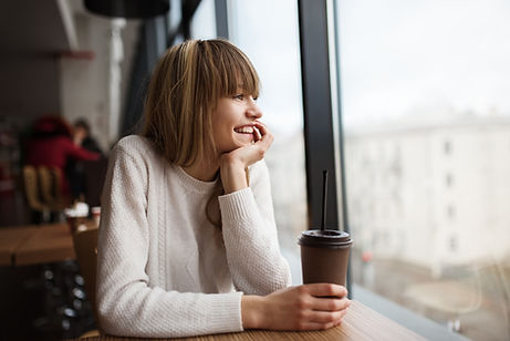 Woman with coffee looking out window. There is hope after depression treatment in St. Louis, MO and after counseling for depression in St. Louis, MO at Marble Wellness 63011