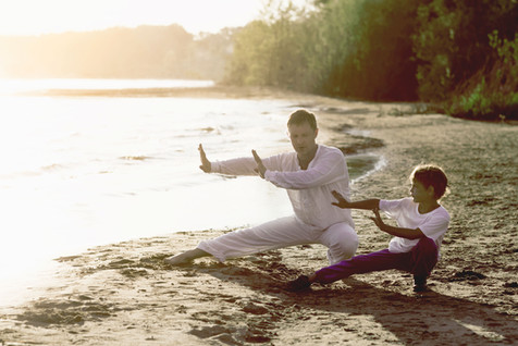 Practicing Tai Chi on the Beach