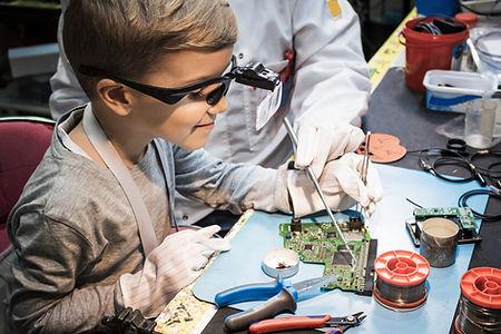 Boy Analyzing Circuit Board