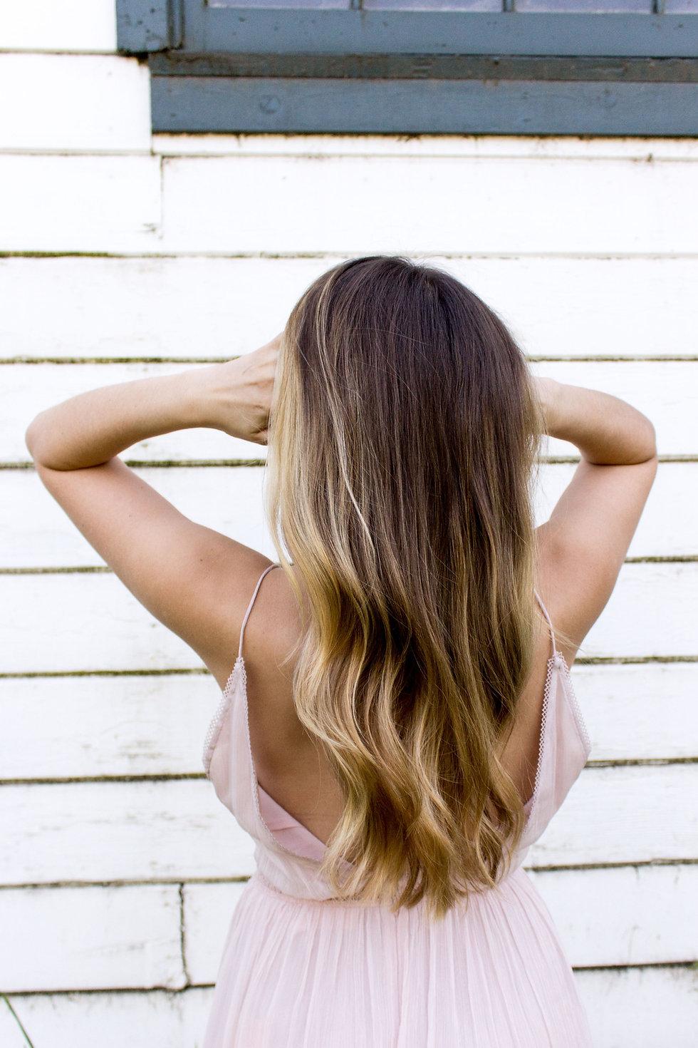Image of woman with hair hi-lights for Salon Envy, hair salon in Highland Park, NJ, near New Brunswick.