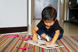 Little Boy with Crayons