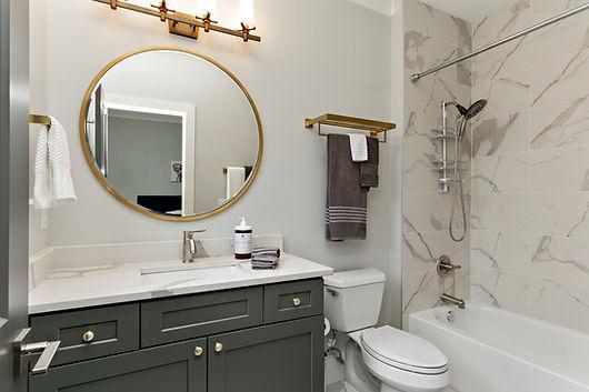 Modern Bathroom with golden framed mirror
