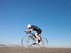 pov of a cyclist riding up a steep hill