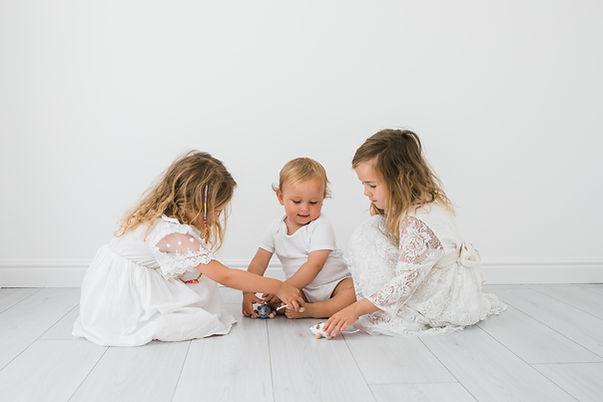 Siblings in White