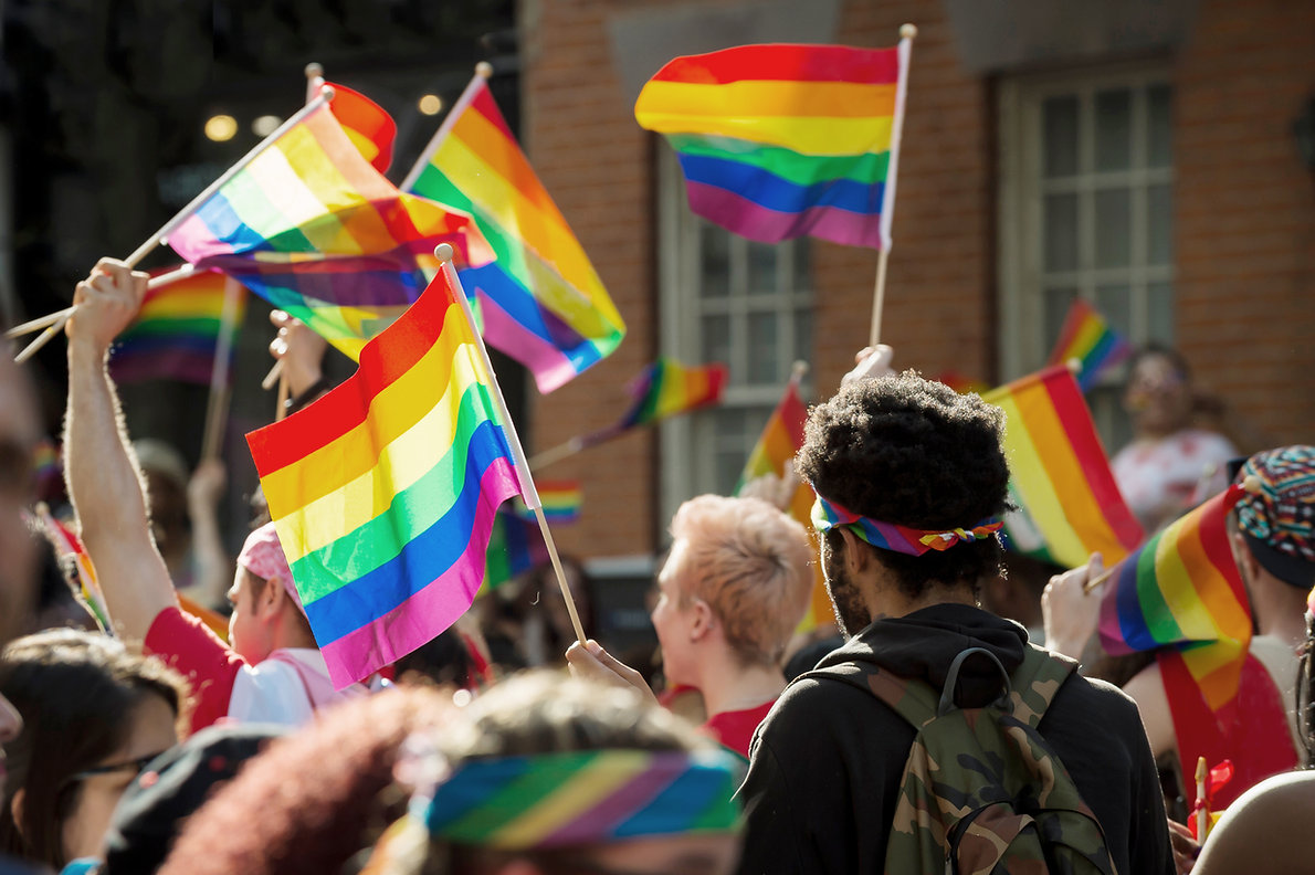 Gay Pride march with rainbow flags