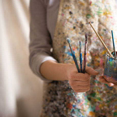 Artist with Paintbrushes
