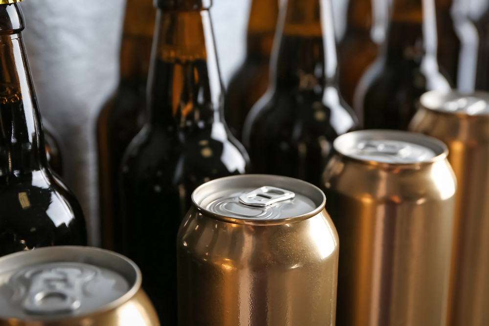 Cans and bottles of unbranded beer after homebrewing