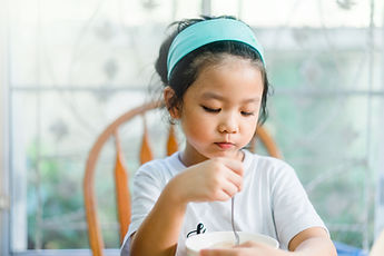 Girl Eating a Meal