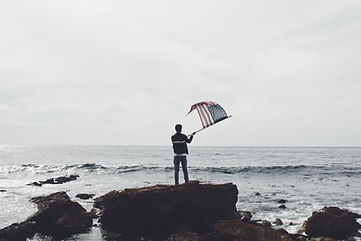 Man Waving American Flag