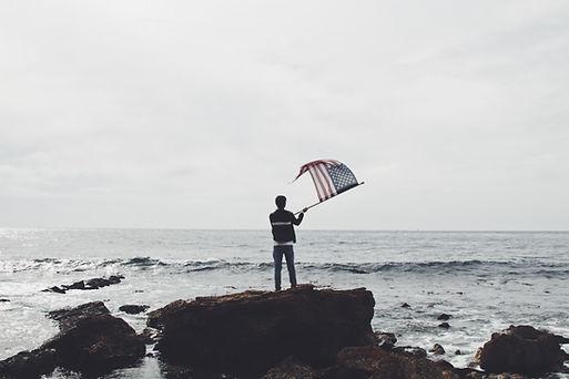 Man Waving American Flag