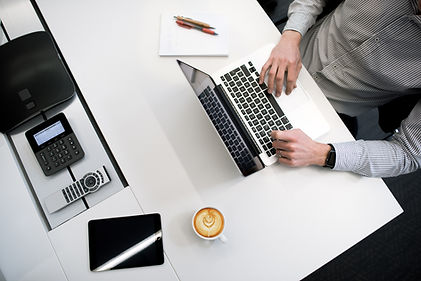 Man on Computer. Connect with other language learners through online meetings