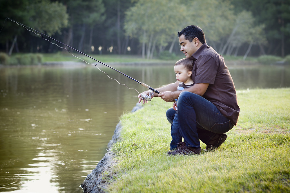 Dad and son fishing on weekend