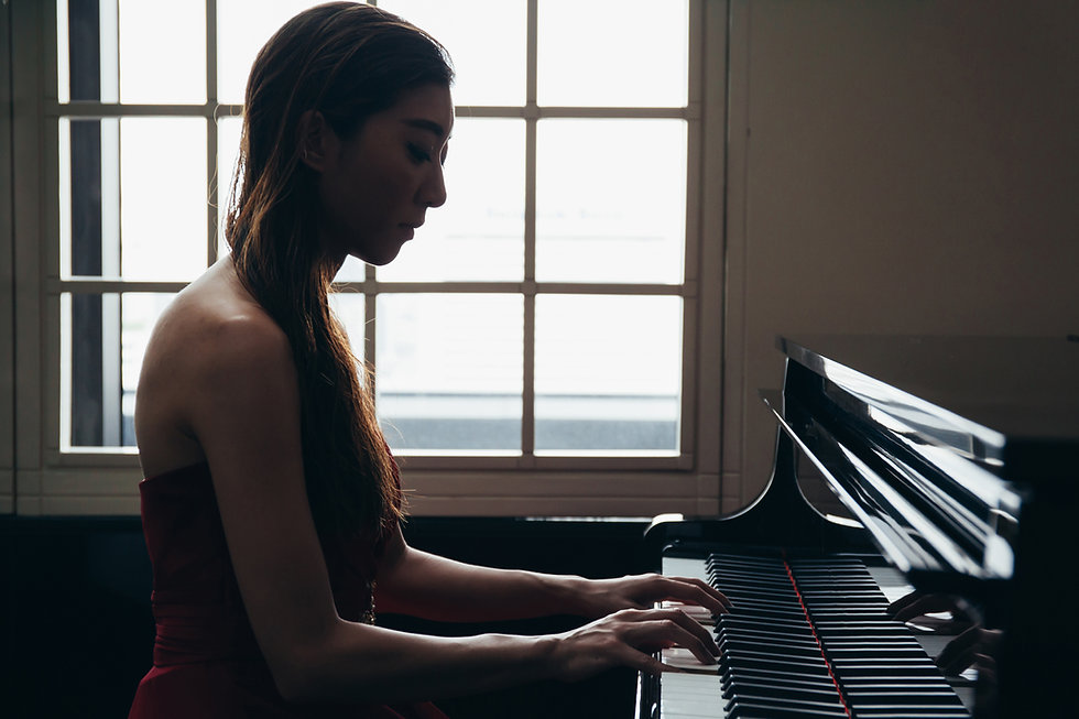 Playing Piano by the Window