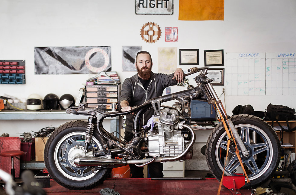 Confident Mechanic with Motorcycle
