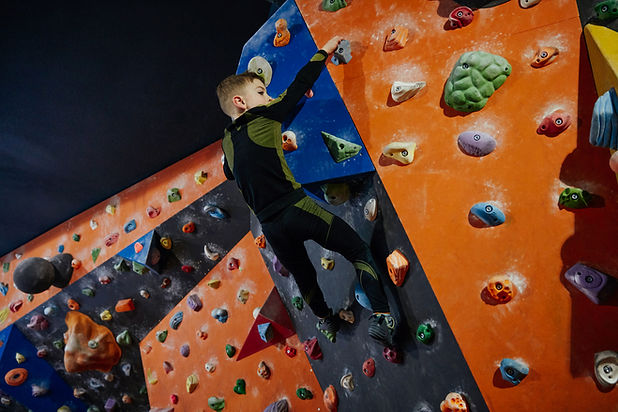 Boy Climbing a Wall