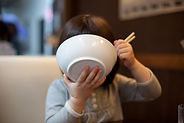 Child Eating from Bowl