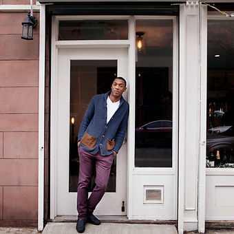 A man standing at a store doorway