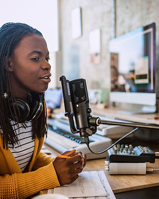 A young woman talking on the radio
