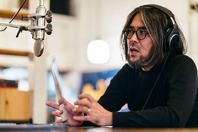 A man talking on the radio