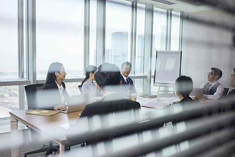 Group Of Business People Sitting Around Table