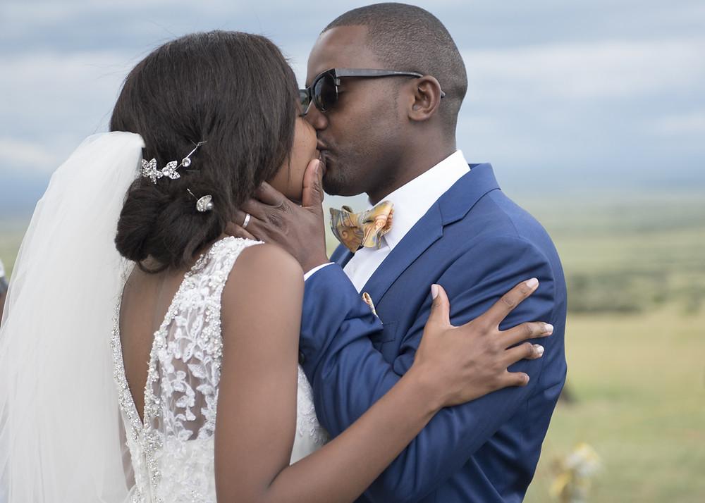 International couple kissing at theit outdoor Danish wedding