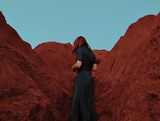 Woman in Rocky Scenery