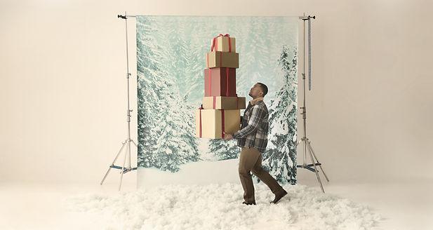 A Man Balancing Gift Boxes