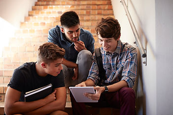 Students Sitting on Staircase