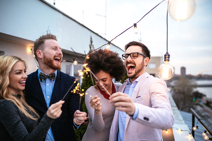 People with sparklers smiling | in-person therapy in Chicago, IL | in-person therapist | therapy in Chicago, IL | therapy for moms | online therapy for moms in illinois | 63122 | forrest glen 60630 | Lincoln Park is 60614 | north center 60613 | 60618