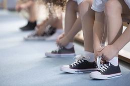 Children Tying Their Shoes